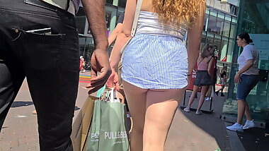 Ass cheeks in shorts